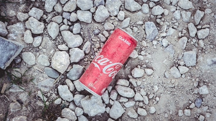 old soda can in the road