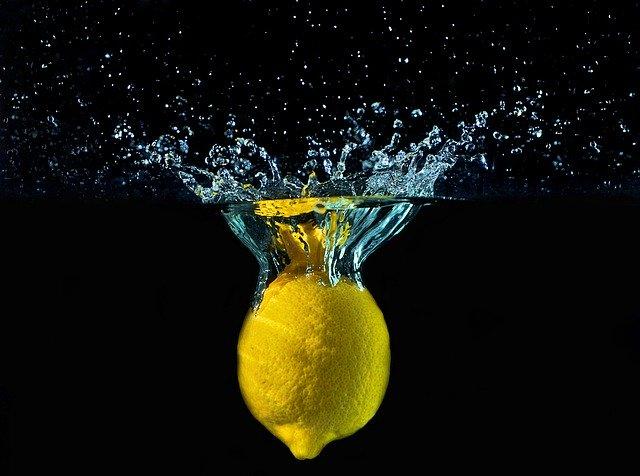 adding lemon to water